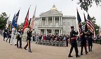 The United States Military All Services Color Guard with New Hampshire Law Enforcement, Fire Service and EMS Color Guards enter the State House Plaza Sunday morning to begin the 10 Year Observance of September 11, 2001 ceremony.  (Karen Bobotas/for the Concord Monitor)