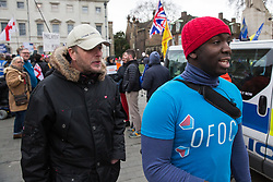 London, UK. 29th January, 2019. A pro-Brexit protester pursues Femi Oluwole, spokesperson of Our Future Our Choice, outside Parliament on the day of votes in the House of Commons on amendments to the Prime Minister's final Brexit withdrawal agreement which could determine the content of the next stage of negotiations with the European Union.