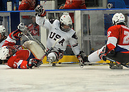 Joe Howard fights for the puck for team USA in the 2010 Paralympic Games