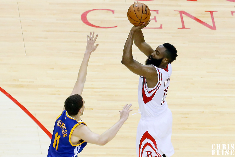 23 May 2015: Houston Rockets guard James Harden (13) takes a jump shot over Golden State Warriors guard Klay Thompson (11) during the Golden State Warriors 115-80 victory over the Houston Rockets, in game 3 of the Western Conference finals, at the Toyota Center, Houston, Texas, USA.