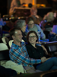 A couple shares a smile while watching a presentation at the once-monthly Nerd Nite event, Monday, April 24, 2017, at Club 21 in the Uptown neighborhood of Oakland, Calif. (Photo by D. Ross Cameron)