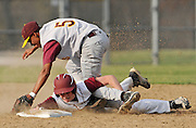 ANDREW JANSEN / JOURNAL.Tommy Koerper, Trinity, hangs onto the bag while Conway Johnson applies the tag in the Titans 8-7 loss to Lutheran North in the season opener.