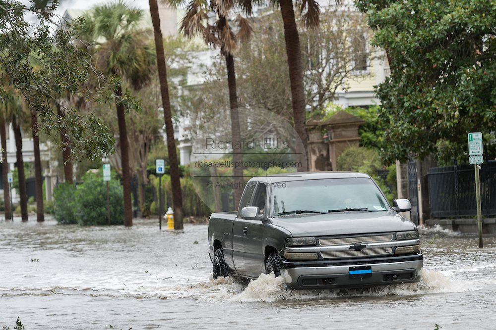 A truck drives through flood water along South Battery Street in historic downtown after Hurricane Matthew passed through causing flooding and light damage to the area October 8, 2016 in Charleston, South Carolina. The hurricane made landfall near Charleston as a Category 2 storm but quickly diminished as it moved north.