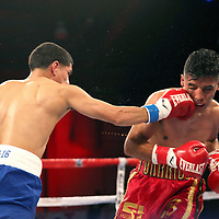 Olympian Antonio Vargas (L) fights against Luis Fernando Saavedra during a Telemundo boxing match between at Osceola Heritage Park on Friday, February 23, 2018 in Kissimmee, Florida.  (Alex Menendez via AP)