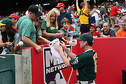 ANAHEIM, CA - JULY 21:  Bob Melvin #6 manager of the Oakland Athletics signs autographs before the game against the Los Angeles Angels of Anaheim on Sunday, July 21, 2013 at Angel Stadium in Anaheim, California. The Athletics won the game in a 6-0 shutout. (Photo by Paul Spinelli/MLB Photos via Getty Images) *** Local Caption *** Bob Melvin