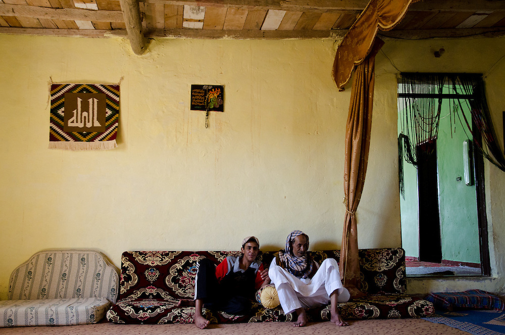 "Rafallah Abdullah and his grandson Rabia, at their home in the Kharouba neighborhood of Marsa Matrouh, Egypt. Rafallah prefers life in the desert, with its greater freedoms; Rabia prefers life in town, ""It's easier to meet girls,"" he says."