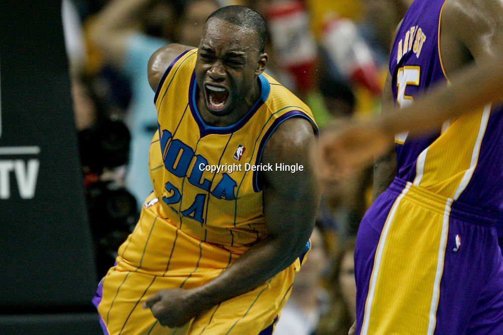April 22, 2011; New Orleans, LA, USA; New Orleans Hornets power forward Carl Landry (24) reacts after a dunk against the Los Angeles Lakers during the second half in game three of the first round of the 2011 NBA playoffs at the New Orleans Arena. The Lakers defeated the Hornets 100-86.   Mandatory Credit: Derick E. Hingle