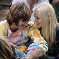 "John Sebastian with girlfriend.- .A man of many faces, clean shaven in The Lovin Spoonful, but now more relaxed as he was reunited with old colleague John Sebastian. Brian Hinton in his book ""Message to Love"" remembers him as being ubiquitous and a symbol of permanence - almost as if his presence was dependent on the success of the festival, he seemed to be everywhere!"
