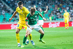 Matija Rom of NK Domzale and Stefan Savic of NK Olimpija during football match between NK Olimpija and NK Domzale in 2nd Round of Prva liga Telekom Slovenije 2019/20, on July 21st, 2019, in Stadium Stozice, Ljubljana, Slovenia. Photo by Grega Valancic / Sportida