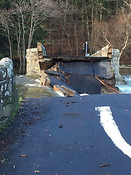 © London News Pictures. 06/12/2015. Pooley Bridge, UK. The bridge at Pooley Bridge in Cumbria which has collapsed following heavy flood water in the area. The North West of England and Scotland have been heavily hit by flood water after unusually heavy rainfall. Photo credit: Ben France/LNP