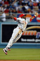 May 12, 2007: Second baseman #4 Brandon Phillips catches the fly ball while leaping through the air during the Los Angeles Dodgers defeated the Cincinnati Reds 7-3 at Dodger Stadium in Los Angeles, CA.