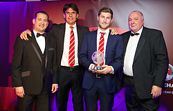 CARDIFF, WALES - Monday, October 6, 2014: Wales' Ben Davies receives the Young Player of the Year award from Andreas Maszczyk, manager Chris Coleman, FAW President Trefor Lloyd-Hughes at the FAW Footballer of the Year Awards 2014 held at the St. David's Hotel. (Pic by David Rawcliffe/Propaganda)