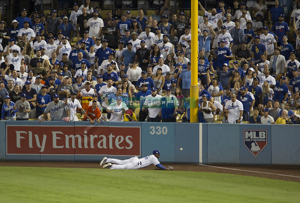 October 25, 2017 - Los Angeles, CALIFORNIA, UNITED STATES OF AMERICA - Yasiel Puig #66 of the Los Angeles Dodgers is unable to catch a ground rule double hit by Alex Bregman #2 of the Houston Astros (not pictured) during the eighth inning in game two of the 2017 World Series at Dodger Stadium on October 25, 2017 in Los Angeles, California.Houston Astros won the game 7 to 6 to tie the series 1-1..ARMANDO ARORIZO. (Credit Image: © Armando Arorizo/Prensa Internacional via ZUMA Wire)