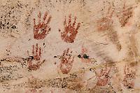 Hand print pictographs in red pigment around Monarch Cave ruins on Comb Ridge; Cedar Mesa, UT