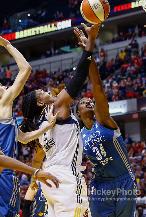 INDIANAPOLIS, IN - OCTOBER 11: Erlana Larkins #2 of the Indiana Fever shoots the ball against Sylvia Fowles #34 of the Minnesota Lynx at Bankers Life Fieldhouse on October 11, 2015 in Indianapolis, Indiana. Indiana defeated Minnesota 75-69. NOTE TO USER: User expressly acknowledges and agrees that, by downloading and or using this photograph, User is consenting to the terms and conditions of the Getty Images License Agreement. (Photo by Michael Hickey/ Getty Images) *** Local Caption *** Erlana Larkins; Sylvia Fowles