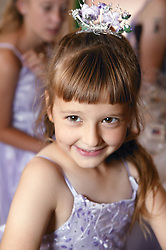 Happy young girl at a wedding wearing bridesmaid dress,
