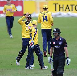 Adam Wheater of Hampshire celebrates with team mates after running out Ian Cockbain of Gloucestershire  - Photo mandatory by-line: Dougie Allward/JMP - Mobile: 07966 386802 - 14/07/2015 - SPORT - Cricket - Cheltenham - Cheltenham College - Natwest T20 Blast