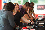 HOUSTON, TX - OCTOBER 3:  Visitors check in for the UFC 192 fan village at the Toyota Center on October 3, 2015 in Houston, Texas. (Photo by Cooper Neill/Zuffa LLC/Zuffa LLC via Getty Images) *** Local Caption ***