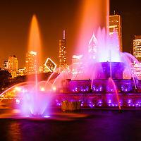 Photo of Chicago at night with Buckingham Fountain.  Officially named the Clarence F. Buckingham Memorial Fountain, the fountain is a very popular attraction located in Grant Park in downtown Chicago. Image is high resolution and was taken in 2012.