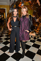 Left to right, ROXIE NAFOUSI and MILLIE MACKINTOSH at a party to celebrate theunveiling of the Claridge's Christmas Tree designed by Christopher Bailey for Burberryheld at Claridge's, Brook Street, London on 18th November 2015.