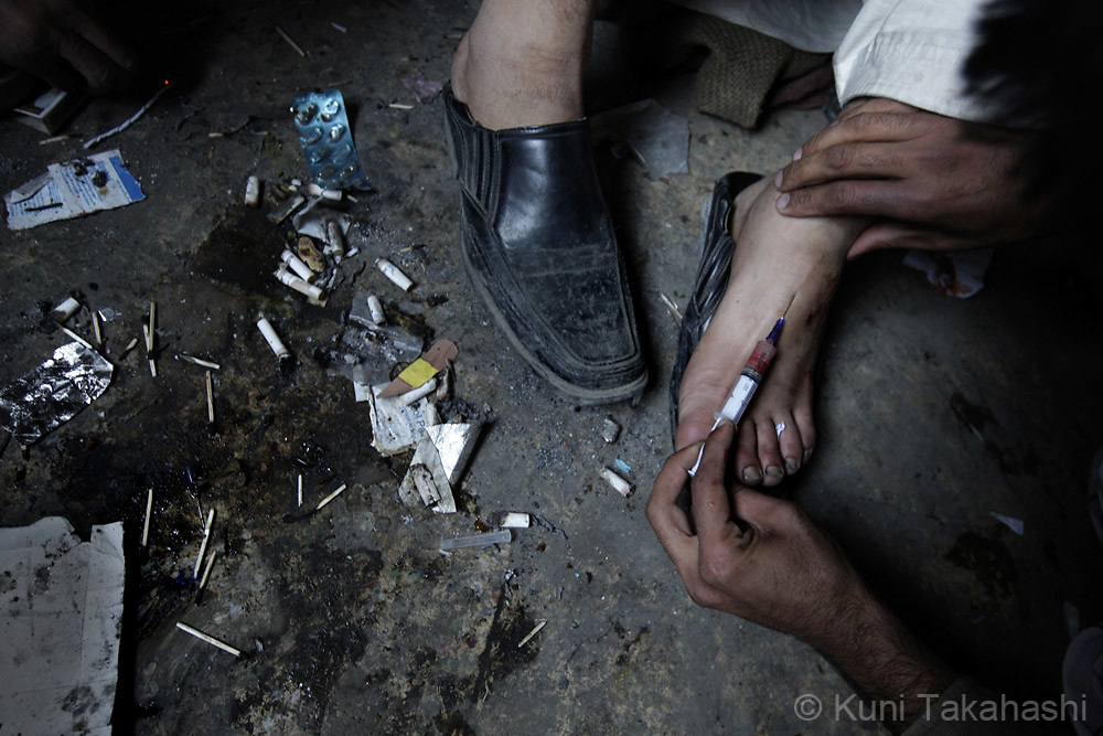 Men inject heroin in an abandoned building in Kabul, Afghanistan on Nov 14, 2008. According to the United Nations, addiction rates in Afghanistan have doubled in the past two years. Nearly a million people are believed to be using illegal drugs, including more than 150,000 opium users and 50,000 heroin addicts.