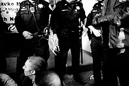Police readies to make arrests outside Bechtel's corporate headquarter, San Francisco, 2004