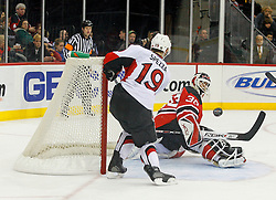 February 13, 2008; Newark, NJ, USA;  Ottawa Senators center Jason Spezza (19) swings and misses on a rebound attempt after a save by New Jersey Devils goalie Martin Brodeur (30) during the third period at the Prudential Center in Newark, NJ. The New Jersey Devils beat the Ottawa Senators 3-2 on an overtime goal by New Jersey Devils right wing Brian Gionta (14).
