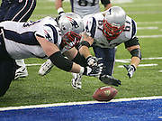 INDIANAPOLIS - JANUARY 21:  Guard Logan Mankins #70 and center Dan Koppen #67 of the New England Patriots dive for a loose ball on the goal line against the Indianapolis Colts during the 2006 AFC Championship game at the RCA Dome on January 21, 2007 in Indianapolis, Indiana. Mankins fell on the ball for a touchdown and a 7-0 lead over the Colts. The Colts defeated the Pats 38-34. ©Paul Anthony Spinelli *** Local Caption *** Logan Mankins;Dan Koppen