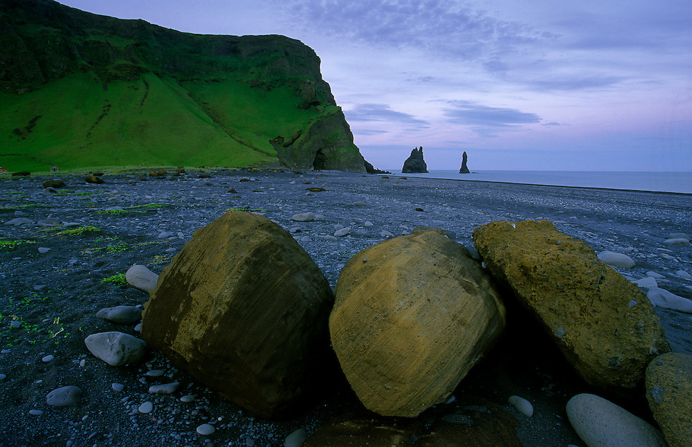 The beach of Reynisfjara, near Vik, is a beach of black volcanic sand. There are some occasional rocks, but most of it is black and dark grey pebbles