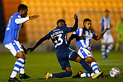 Colchester United defender Ryan Jackson (2) tackles Southend United player Renei Batlokwa during the EFL Trophy match between Colchester United and Southend United at the Weston Homes Community Stadium, Colchester, England on 9 October 2018.