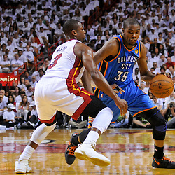 Jun 17, 2012; Miam, FL, USA; Oklahoma City Thunder small forward Kevin Durant (35) is guarded by Miami Heat shooting guard Dwyane Wade (3) during the second quarter in game three in the 2012 NBA Finals at the American Airlines Arena. Mandatory Credit: Derick E. Hingle-US PRESSWIRE
