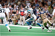 Defensive back Deon Grant (27) of the Carolina Panthers runs after intercepting a pass with Wide receiver Torry Holt (88) of the St. Louis Rams right behind during a 48 to 14 win by the Rams on 11/11/2001..©Wesley Hitt/NFL Photos