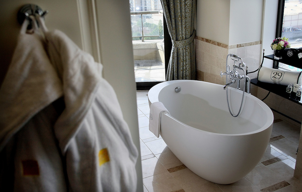 A pair of robes hang near the oversized bath tub in the Mansion on Peachtree hotel's Presidential suite.