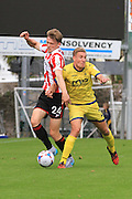 Rob Dickie and Simon Heslop during the Vanarama National League match between Torquay United and Cheltenham Town at Plainmoor, Torquay, England on 29 August 2015. Photo by Antony Thompson.