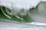 Greg Long and Jamie Sterling surf a monster wave during Heat 1 at the 2008 Mavericks Surf Contest on January 12 2008