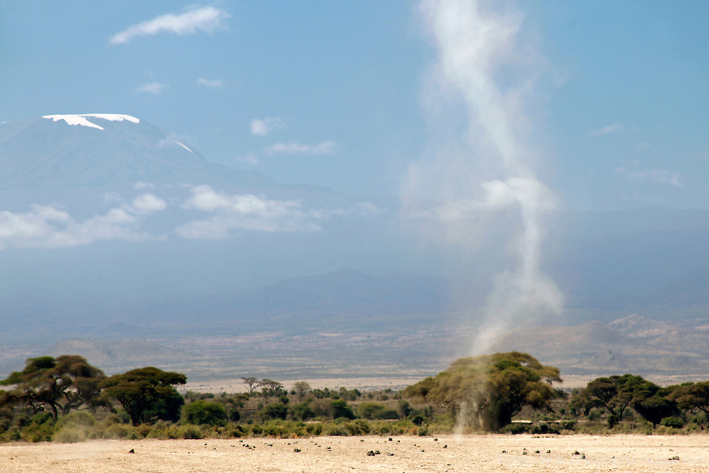 Africa, Kenya, Amboseli. A dust devil with Mt. Kilimanjaro in the distance.