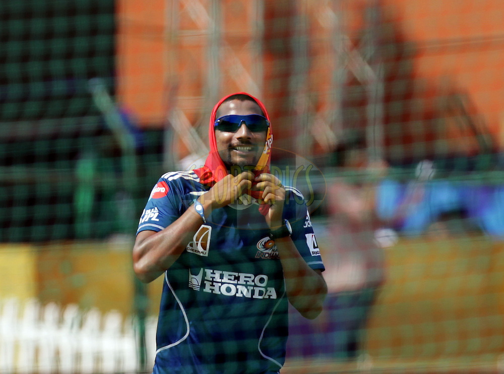 Mumbai Indian player Ali Murtaza cover himself with the bib during match 34 of the the Indian Premier League ( IPL ) Season 4 between the Rajasthan Royals and the Mumbai Indians held at the Sawai Mansingh Stadium, Jaipur, Rajasthan, India on the 29th April 2011..Photo by BCCI/SPORTZPICS..