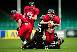 East Kilbride Pirates quarter back pitches the ball as he's tackled - Mandatory by-line: Jason Brown/JMP - 27/08/2016 - AMERICAN FOOTBALL - Sixways Stadium - Worcester, England - Kent Exiles v East Kilbride Pirates - BAFA Britbowl Finals Day
