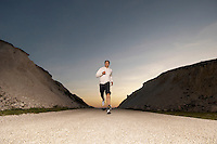 Mid adult man jogging in evening