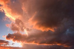 Deep orange yellow sunset clouds, sky view only, over San Luis Valley, Colorado