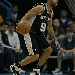 Jan 18, 2010; New Orleans, LA, USA; San Antonio Spurs guard Tony Parker (9) controls the ball against the New Orleans Hornets during the second half at the New Orleans Arena. The Spurs defeated the Hornets 97-90. Mandatory Credit: Derick E. Hingle-US PRESSWIRE