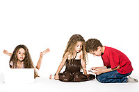 caucasian kids playing console game and computer isolated studio on white background