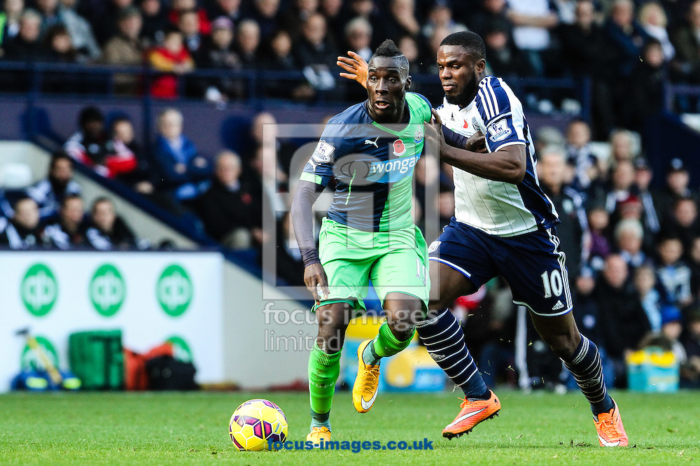 Massadio Haidara of Newcastle United (left) competing with Victor Anichebe of West Bromwich Albion (right) during the Barclays Premier League match at The Hawthorns, West Bromwich<br /> Picture by Andy Kearns/Focus Images Ltd 0781 864 4264<br /> 09/11/2014