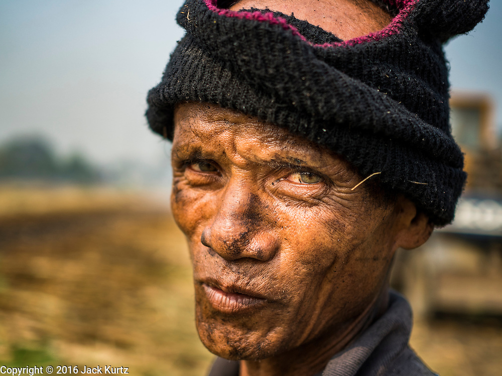 02 FEBRUARY 2016 - THUNG KHOK, SUBPAN BURI, THAILAND: A migrant farm worker from eastern Thailand in a sugar cane field during the harvest in Suphan Buri province, in western Thailand. Thai sugar cane yields are expected to drop by about two percent for the 2015/2016 harvest because of below normal rainfall. The size of the crop is expected to increase slightly though because farmers planted more sugar cane acreage this year. Thailand is the second leading exporter of sugar in the world. Thai sugar growers are hoping a good crop would make up for shortages in global markets caused by lower harvests in Brazil and Australia, where sugar yields have been stunted by drought. Because of the drought in Thailand, sugar exports are expected to drop by up to 20 percent, contributing to a global sugar shortage. The drought is is also hurting the quality of Thai sugar, because sugarcane grown in drought is less sweet than normal so mills need to process more cane to make the same amount of sugar. Thai sugar farmers have lost 20 percent to 30 percent of their output this year because of the drought.        PHOTO BY JACK KURTZ