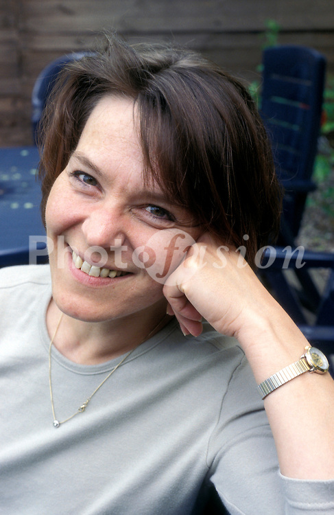 Portrait of middle aged woman smiling; UK