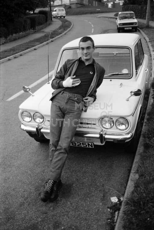 Boy Leaning on His Car, High Wycombe, UK, 1980s.