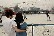 Zhengzhou, June 22nd 2013<br /> A young couple by a skating ring. Skating is one of the most popular out-of-work activity for the Foxconn workers here.