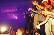 Clubbers up on stage dancing, UK 2000's