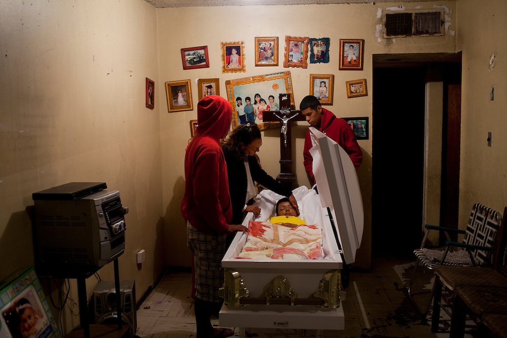 Family members grieve during the wake of a 14 yeard old girl who was shot and killed in Ciudad Juarez.