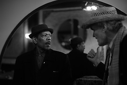"WASHINGTON, DC - September 14: Bill ""Magic"" Lavender Bey, left, and saxophonist Knud Jensen discuss the setup while arriving at Columbia Station in Washington, D.C., September 14, 2014. (Photo by Astrid Riecken)"